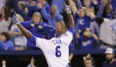 Kansas City Royals Lorenzo Cain (6) celebrates after hitting in the game-winning run in the ninth inning of a baseball game against the Washington Nationals at Kauffman Stadium in Kansas City, Mo., Tuesday, May 3, 2016. The Royals beat the Nationals 7-6. (AP Photo/Colin E. Braley)