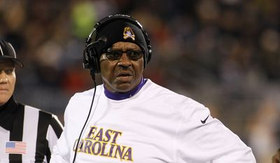 East Carolina head coach Ruffin McNeill questions a call during the second quarter of an NCAA college football game against Connecticut, Friday, Oct. 30, 2015, in East Hartford, Conn. (AP Photo/Stew Milne)