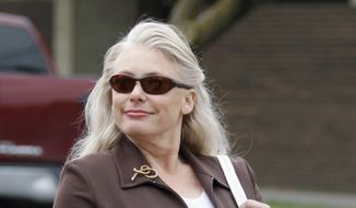 In this April 20, 2011 file photo, Angel Dillard of Valley Center, Kan., arrives at the U.S. Federal District Courthouse in Wichita, Kan. (AP Photo/Jeff Tuttle, File)