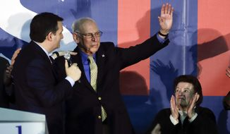 In this Feb. 1, 2016, file photo, Republican presidential candidate, Sen. Ted Cruz, R-Texas, greets his father Rafael as his mother Eleanor Darragh applauds during a rally in Des Moines, Iowa. (AP Photo/Chris Carlson, File)