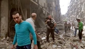 In this Thursday, April 28, 2016, file image made from video and posted online from Validated UGC, a man carries a child after airstrikes hit Aleppo, Syria. Syrian state TV on Tuesday, May 3, 2016, says dozens of people have been killed or wounded when rebels fired rockets into a government-held neighborhood of the northern city of Aleppo. (Validated UGC via AP video, File)