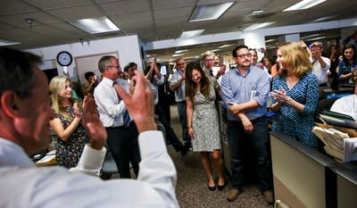 Tampa Bay Times Editor Neil Brown, from left, claps as reporter Leonora LaPeter Anton, Times Chairman and CEO Paul Tash, and reporters Lisa Gartner, Michael LaForgia and Cara Fitzpatrick celebrate winning two Pulitzer prizes, in the Times' newsroom in St. Petersburg, Fla., Monday, April 18, 2016. The Times won two Pulitzer prizes for Investigative Reporting and Local Reporting. (Will Vragovic/The Tampa Bay Times via AP) MANDATORY CREDIT