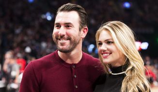 This is a Feb. 14, 2016, file photo showing Detroit Tigers pitcher Justin Verlander and model Kate Upton posed during halftime at the NBA All-Star basketball game in Toronto. (Mark Blinch/The Canadian Press via AP, File)