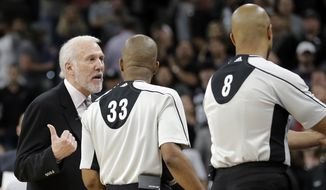 San Antonio Spurs head coach Gregg Popovich, left, argues with officials during the second half in Game 2 of a second-round NBA basketball playoff series, Monday, May 2, 2016, in San Antonio. Oklahoma City won 98-97. (AP Photo/Eric Gay)