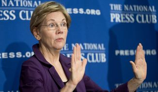 "FILE - In this Nov. 18, 2015, file photo, Sen. Elizabeth Warren, D-Mass. gestures before speaking at the National Press Club in Washington. Warren has taken to Twitter to attack what she calls presumptive Republican presidential nominee Donald Trump's ""toxic stew of hatred & insecurity."" She put out a series of tweets Tuesday night as results from the GOP primary in Indiana left Trump as the overwhelming favorite to become the GOP nominee. (AP Photo/Pablo Martinez Monsivais, File)"