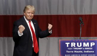 In this Sunday, May 1, 2016, file photo, Republican presidential candidate Donald Trump reacts to a song during a campaign rally at the Indiana Theater in Terre Haute, Ind. (AP Photo/Seth Perlman) ** FILE **
