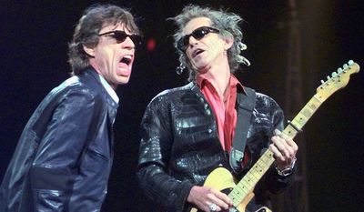 "FILE - In this Monday, March 22, 1999, file photo, Mick Jagger, left, and Keith Richards perform ""Jumping Jack Flash"" during the Rolling Stones' No Security Tour performance at the Fleet Center in Boston. Goldenvoice Entertainment, a subsidiary of AEG Live, announced Tuesday, May 3, 2016, that Paul McCartney, the Rolling Stones, Roger Waters, Neil Young, The Who and Bob Dylan will perform for Desert Trip, during a three-day concert, Oct. 7-9, 2016, at the desert grounds where the annual Coachella Valley Music and Arts festival is held in Indio, Calif. (AP Photo/Elise Amendola, File)"