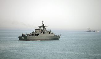 In this Tuesday, April 7, 2015, photo released by the semi-official Fars News Agency, Iranian warship Alborz, foreground, prepares before leaving Iran's waters, at the Strait of Hormuz. (AP Photo/Fars News Agency, Mahdi Marizad/File)