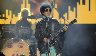 In this May 19, 2013, file photo, Prince performs at the Billboard Music Awards at the MGM Grand Garden Arena in Las Vegas. In a newspaper report published Wednesday, May 4, 2016, Prince had arranged to meet a California doctor to try to kick an addiction to painkillers shortly before his death. (Photo by Chris Pizzello/Invision/AP, File)