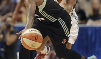 FILE - In this Aug. 29, 2015 file photo, New York Liberty's Epiphanny Prince steals the ball from Connecticut Sun's Jasmine Thomas, back, during the second half of a WNBA basketball game in Uncasville, Conn. The WNBA and its players union have agreed to amend the collective bargaining agreement on fines for overseas play. According to emails obtained by The Associated Press, players will no longer be fined for missing time for overseas national team commitments if they notify their WNBA teams in advance. About a dozen players, including Epiphanny Prince, Natalie Achonwa, Shavonte Zellous and Allie Quigley, missed games last season and were subsequently fined. (AP Photo/Jessica Hill, File)
