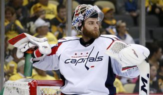 Washington Capitals goalie Braden Holtby takes a time out during the second period of Game 3 in an NHL hockey Stanley Cup Eastern Conference semifinals against the Pittsburgh Penguins in Pittsburgh, Monday, May 2, 2016. (AP Photo/Gene J. Puskar)