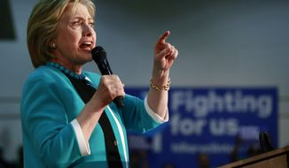 Democratic presidential candidate Hillary Clinton campaigns at East Los Angeles College in Los Angeles, Thursday, May 5, 2016. (AP Photo/Damian Dovarganes)
