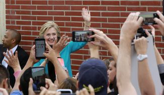 Democratic presidential candidate Hillary Clinton waves to students campaigns at East Los Angeles College in Los Angeles, Thursday, May 5, 2016. (AP Photo/Damian Dovarganes)