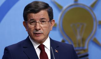Turkish Prime Minister Ahmet Davutoglu speaks to the media at the headquarters of his ruling Justice and Development Party, AKP, in Ankara, Turkey, Thursday, May 5, 2016. Davutoglu announced his resignation on Thursday, paving the way for the country's president to pursue a tighter grip on power. (AP Photo/Burhan Ozbilici)