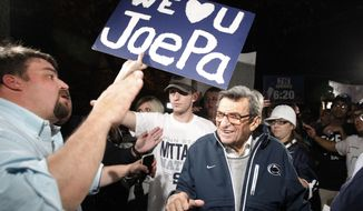 "In this Nov. 8, 2011, file photo, Scott Paterno, left, looks on as students greet his father Penn State football coach Joe Paterno as he arrives at his home in State College, Pa. Scott Paterno said in a tweet sent May 6, 2016, that an allegation made by insurers that a boy told the longtime Penn State football coach in 1976 that he had been molested by former assistant coach Jerry Sandusky is ""bunk."" (AP Photo/Matt Rourke, File)"