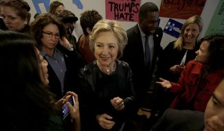 Democratic presidential candidate Hillary Clinton, center, greets supporters as she visits her campaign field office in Oakland, Calif., Friday, May 6, 2016. (AP Photo/Jeff Chiu)