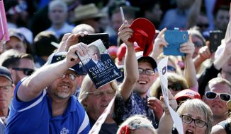 Supporters reach for autographs from Republican presidential candidate Donald Trump after a rally Saturday, May 7, 2016, in Lynden, Wash. (AP Photo/Elaine Thompson)