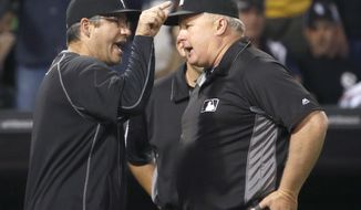 Chicago White Sox's Robin Ventura, left, argues with umpire crew chief Bill Miller after Jose Abreu was hit by a pitch from Minnesota Twins relief pitcher Trevor May during the eighth inning of a baseball game Friday, May 6, 2016, in Chicago. Miller ejected Ventura and the White Sox went on to win 10-4. (AP Photo/Charles Rex Arbogast)