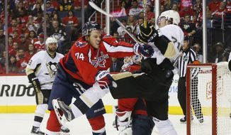 Washington Capitals defenseman John Carlson (74) and Pittsburgh Penguins center Evgeni Malkin (71) shove each other in from of the net during the third period of Game 5 in an NHL hockey Stanley Cup Eastern Conference semifinals Saturday, May 7, 2016 in Washington. Washington won 3-1. (AP Photo/Pablo Martinez Monsivais)