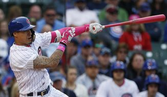 Chicago Cubs' Javier Baez hits the game-winning solo home run against the Washington Nationals during the 13th inning of a baseball game Sunday, May 8, 2016, in Chicago. The Cubs won 4-3. (AP Photo/Nam Y. Huh)