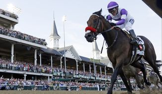 Mario Gutierrez rides Nyquist to victory during the 142nd running of the Kentucky Derby horse race at Churchill Downs Saturday, May 7, 2016, in Louisville, Ky. (AP Photo/David J. Phillip)