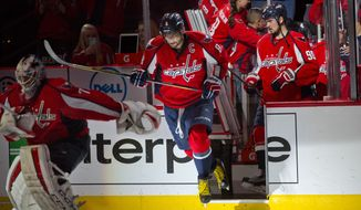 Washington Capitals goalie Braden Holtby (70), Alex Ovechkin (8) and center Marcus Johansson (90) take the ice as they start the third period  of Game 5 in an NHL hockey Stanley Cup Eastern Conference semifinals against Pittsburgh Penguins Saturday, May 7, 2016 in Washington. Capitols won 3-1. (AP Photo/Pablo Martinez Monsivais)