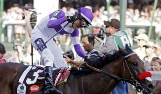 CORRECTS LAST NAME TO GUTIERREZ FROM GUITIERREZ - Mario Gutierrez celebrates after riding Nyquist to victory during the 142nd running of the Kentucky Derby horse race at Churchill Downs Saturday, May 7, 2016, in Louisville, Ky. (AP Photo/Garry Jones)