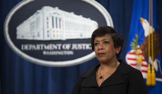 Attorney General Loretta Lynch pauses during a news conference at the Justice Department in Washington, Monday, May 9, 2016. North Carolina Gov. Pat McCrory's administration sued the federal government Monday in a fight for a state law that limits protections for lesbian, gay, bisexual and transgender people. (AP Photo/Evan Vucci)