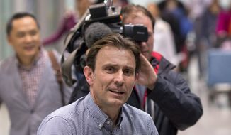 "BBC's journalist Rupert Wingfield-Hayes arrives at the airport in Beijing, China, Monday, May 9, 2016. North Korea on Monday expelled the BBC journalist it had detained days earlier for allegedly ""insulting the dignity"" of the authoritarian country, while it continued to keep other foreign media away from the first-in-decades ruling party congress they had been invited to attend. (AP Photo/Ng Han Guan)"