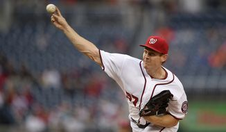 Washington Nationals starting pitcher Stephen Strasburg (37) delivers a pitch during the first inning of an interleague baseball game against the Detroit Tigers, Monday, May 9, 2016, in Washington. (AP Photo/Nick Wass)