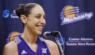 Phoenix Mercury's Diana Taurasi smiles as she speaks during a news conference at the team's basketball media day, Monday, May 9, 2016, in Phoenix. (AP Photo/Ross D. Franklin)