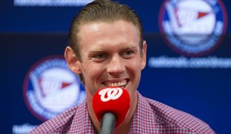 Washington Nationals starting pitcher Stephen Strasburg smiles during a news conference to announce a seven-year contract extension that will pay Strasburg $175 million starting in 2017, at Nationals Park, on Tuesday, May 10, 2016, in Washington. (AP Photo/Evan Vucci)