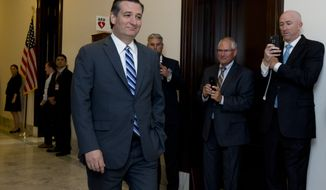 Former Republican presidential, candidate Sen. Ted Cruz, R-Texas, walks past reporters as he returns to the Capitol Hill in Washington, Tuesday, May 10, 2016 . (AP Photo/Manuel Balce Ceneta)