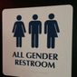 "An ""All Gender Restroom"" sign hangs outside a bathroom in a bar in Washington. Confrontations have flared across the country over whether to protect or curtail the right of transgender people to use public restrooms in accordance with their gender identity. (Associated Press) ** FILE **"