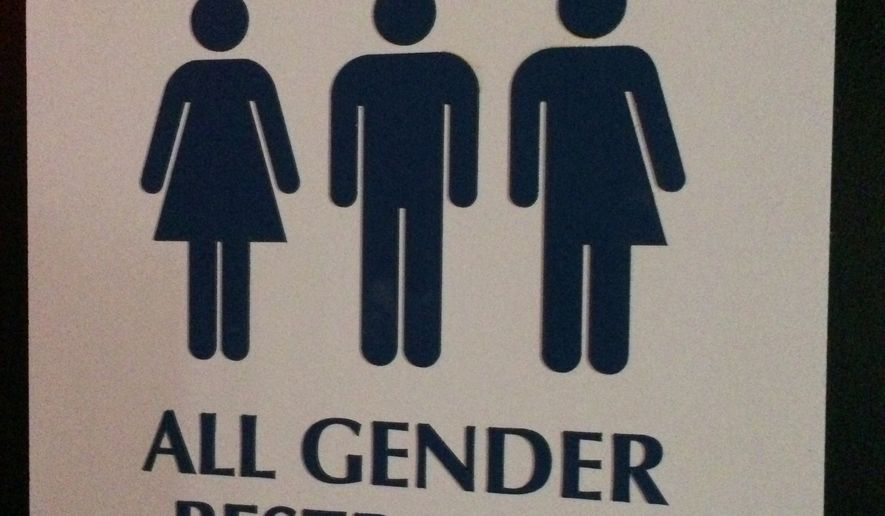 "An ""All Gender Restroom"" sign hangs outside a bathroom in a bar in Washington. (Associated Press) ** FILE **"