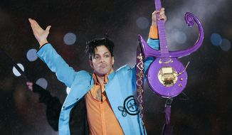 In this Feb. 4, 2007, file photo, Prince performs during halftime of the Super Bowl XLI football game in Miami. (AP Photo/Chris O'Meara, File)