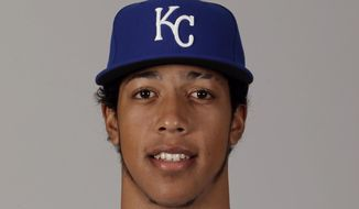 This is a 2016 file photo of Raul Mondesi of the Kansas City Royals baseball team. This image reflects the Kansas City Royals active roster as of Thursday, Feb. 25, 2016, when this image was taken. Kansas City Royals infield prospect Raul Mondesi was suspended for 50 games following a positive test for Clenbuterol, negotiating a 30-game reduction from the usual penalty for a banned steroid after providing evidence he ingested the drug in an over-the-counter medication. The penalty, announced Tuesday, May 10, 2016. (AP Photo/Charlie Riedel, File)