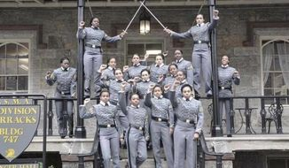 This undated file image obtained from Twitter on Saturday, May 7, 2016, shows 16 black, female cadets in uniform with their fists raised while posing for a photograph at the United States Military Academy at West Point, N.Y. The U.S. Military Academy said Tuesday, May 10, that it concluded the group photo didn't violate any Department of Defense rules limiting political activity. (Obtained from Twitter via AP, FIle)