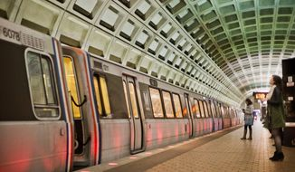 In this photo taken March 12, 2015, passengers wait on the platform before boarding a train at the U Street Metro Station in Washington. (AP Photo/Pablo Martinez Monsivais) ** FILE **