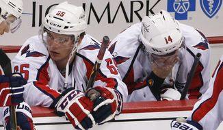 Washington Capitals' Andre Burakovsky (65) and Justin Williams (14) sit on the bench after the Capitals lost to the Pittsburgh Penguins in overtime of Game 6 of the NHL hockey Stanley Cup Eastern Conference semifinals, Tuesday, May 10, 2016 in Pittsburgh. The Penguins won 4-3 and advanced to the conference finals. (AP Photo/Gene J. Puskar)
