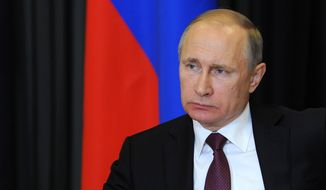 Russian President Vladimir Putin listens during a live video link with regions suffering from forest fires from the Bocharov Ruchei residence in the Russian Black Sea resort of Sochi on Wednesday, May 11, 2016. Russia's president has flipped the switch to open the last of four electricity lines to Crimea aimed at allowing the Russia-annexed peninsula to end its reliance on Ukrainian electricity.  (Mikhail Klimentyev/Sputnik, Kremlin Pool Photo via AP)