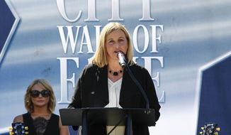 FILE - In this Oct. 6, 2015 file photo, Nashville Mayor Megan Barry addresses the crowd at Music City Walk of Fame Induction Ceremony at Walk of Fame Park in Nashville, Tenn. (Photo by Al Wagner/Invision/AP, File) **FILE**
