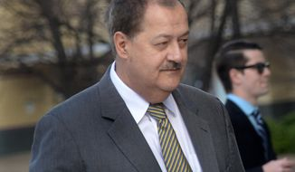 FILE - In a Wednesday, April 6, 2016 file photo, former Massey CEO Don Blankenship is escorted by Homeland Security officers from the Robert C. Byrd U.S. Courthouse in Charleston, W.Va. A federal appeals court rejected a bid Thursday May 12, 2016, by Blankenship to remain free while the court considers an appeal of his conviction related to the deadliest U.S. mine explosion in four decades.  A three-judge panel of the 4th U.S. Circuit Court of Appeals announced the ruling the same day Blankenship was scheduled to report to start serving his one-year sentence. (F. Brian Ferguson/Charleston Gazette-Mail via AP, File) MANDATORY CREDIT