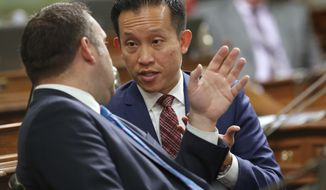 Assemblyman David Chiu, D-San Francisco, right, talks with Assemblyman Adam Gray, D-Merced, during the Assembly session, Thursday, May 12, 2016, in Sacramento, Calif. By a 72-0 vote the Assembly approved Chiu's bill, Thursday, requiring local police departments to report how many rape kits they collect and give a reason for every kit that goes untested. The bill, AB1848, now goes to the Senate. (AP Photo/Rich Pedroncelli)