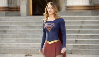 """In this image released by CBS, Melissa Benoist appears in a scene from """"Supergirl."""" The CW said Thursday, May 12, 2016, that it's picking up the series from CBS, where it debuted last year. (Darren Michaels/Warner Bros. Entertainment Inc. via AP)"""