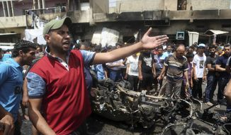 Citizens gather at the scene after a car bomb explosion at a crowded outdoor market in the Iraqi capital's eastern district of Sadr City, Iraq, Wednesday, May 11, 2016. An explosives-laden car bomb ripped through a commercial area in a predominantly Shiite neighborhood of Baghdad on Wednesday, killing and wounding dozens of civilians, a police official said. (AP Photo/ Khalid Mohammed, File) ** FILE **