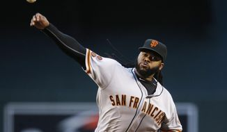 San Francisco Giants' Johnny Cueto throws a pitch against the Arizona Diamondbacks during the first inning of a baseball game Thursday, May 12, 2016, in Phoenix. (AP Photo/Ross D. Franklin)