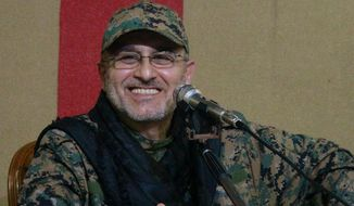 This undated handout image released on Friday, May 13, 2016, by Hezbollah Media Department, shows slain top military commander Mustafa Badreddine smiling during a meeting. Lebanon's militant Hezbollah group said its top military commander Mustafa Badreddine was killed in Syria. (Hezbollah Media Department via AP)