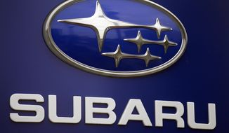 FILE - In this Aug. 31, 2011, file photo, a Subaru logo is displayed on a sign at a dealer's lot, in Portland, Ore. Subaru is telling owners of some newer Legacy and Outback vehicles not to drive them because the steering can fail. The company is recalling about 52,000 of the cars and SUVs from the 2016 and 2017 model years. It also has told dealers to stop selling them until they're repaired. (AP Photo/Rick Bowmer, File)