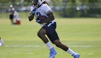 Tennessee Titans running back Derrick Henry runs a drill during NFL football rookie minicamp Friday, May 13, 2016, in Nashville, Tenn. (AP Photo/Mark Humphrey)